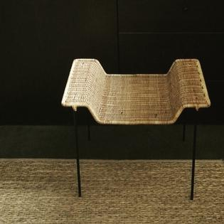 A rotan and black metal side table