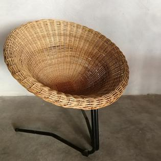 A rotan and black metal vintage lounge chair