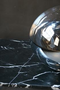 A vintage mirror glass table lamp