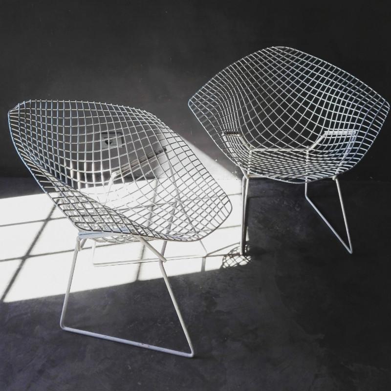 Pair Of White Bertoia Diamond Chairs